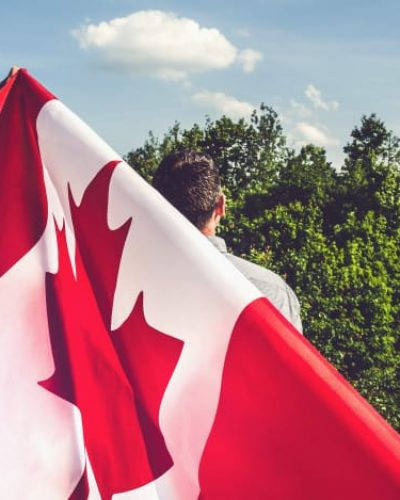 handsome-man-with-canadian-flag_78967-1820